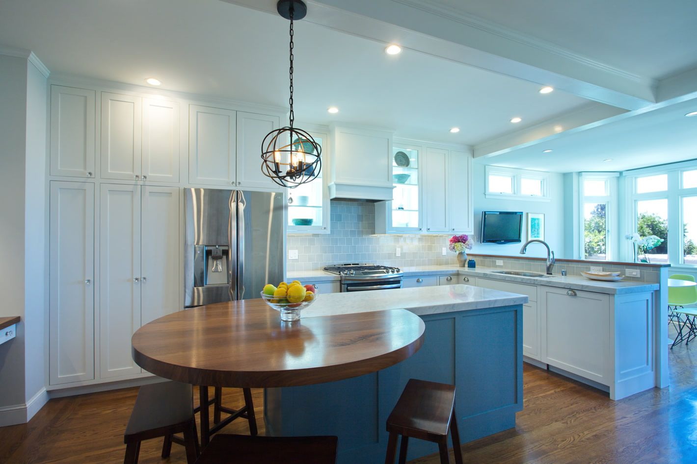 Transitional, shaker style with circular eating bar/island unit ...