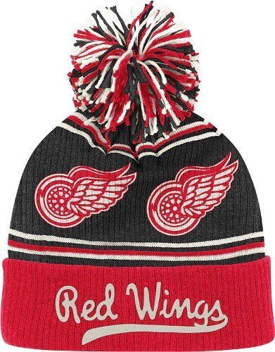 Detroit Red Wings CCM Repeating Logo Cuffed Pom Knit Hat by Reebok.  19.95.  Keep d94f94d3279e