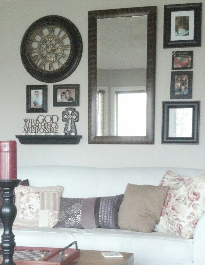 Antique Mirror In Wall Arrangement With Large Clock And Family Snapshots Nothing Formal Large Wall Decor