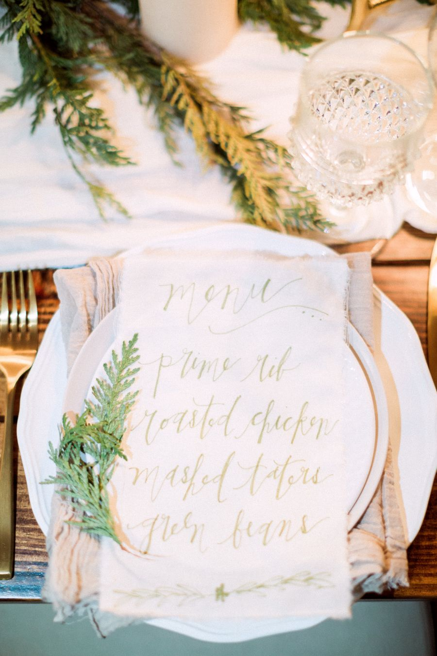 Menu cards.  Photography: Hunter Ryan Photo - hunterryanphoto.com   Read More on SMP: http://www.stylemepretty.com/living/2016/12/09/a-cozy-candlelit-holiday-gathering/