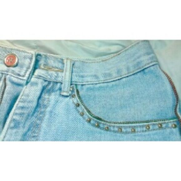 75% off Vintage 80s decorated Jean shorts With grunge and hipster fashion in high swing, these 80s Levi-like durability shorts are uniquely decorated on the edges and pockets of the shorts (front and back) with colored zipper line (green for pockets and red for sides). Front pockets are lined with gold studs. Red gold button with vintage light Jean material with folded up hem. Sit comfortably a little above waist line. So cute with a plain tank and some converse for a timeless look! In great…