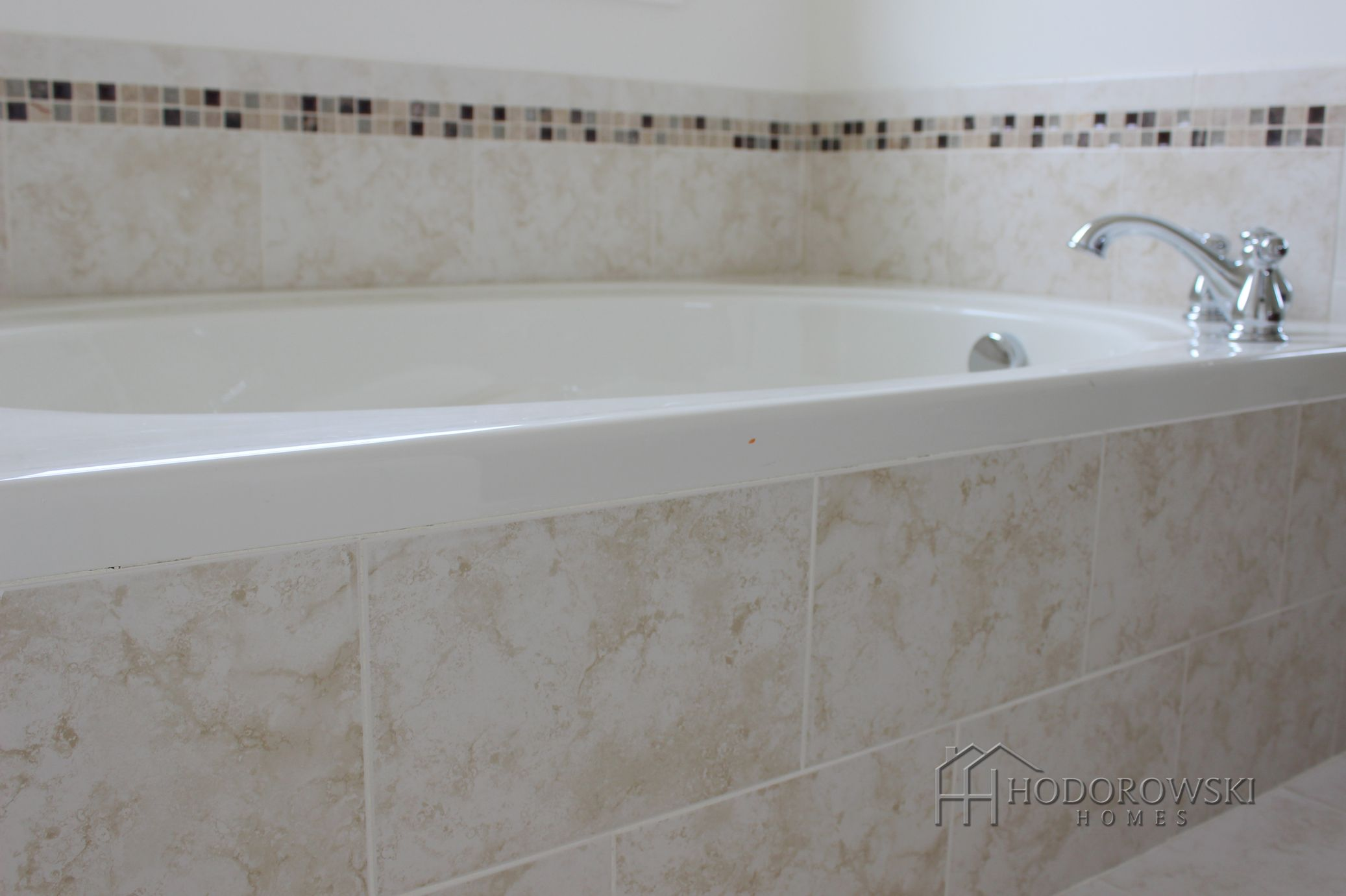 - This Garden Tub Chose Brick-laid City Collection Cream Tile With