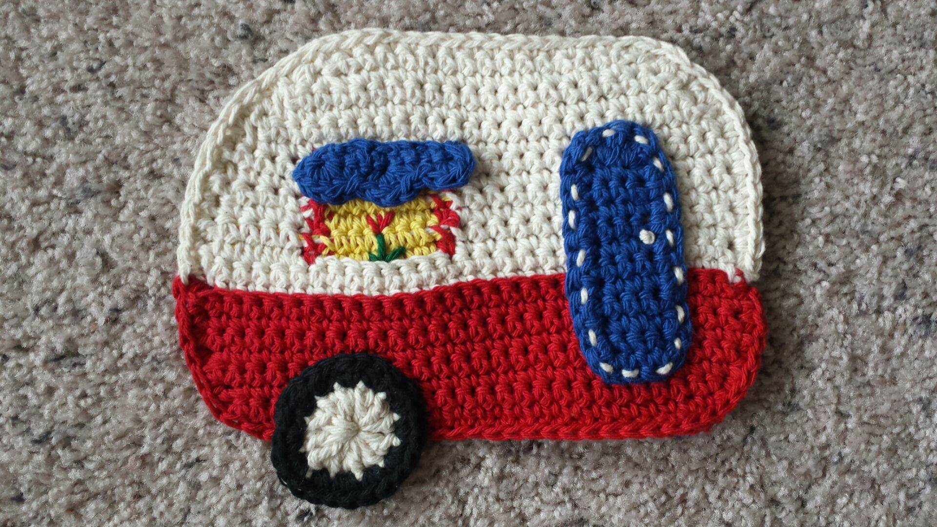 """I'm happy to report that I pushed pause long enough on my basket frenzy to actually complete one of my other crochet projects! I'm calling it my """"Happy Camper"""" potholder! I …"""