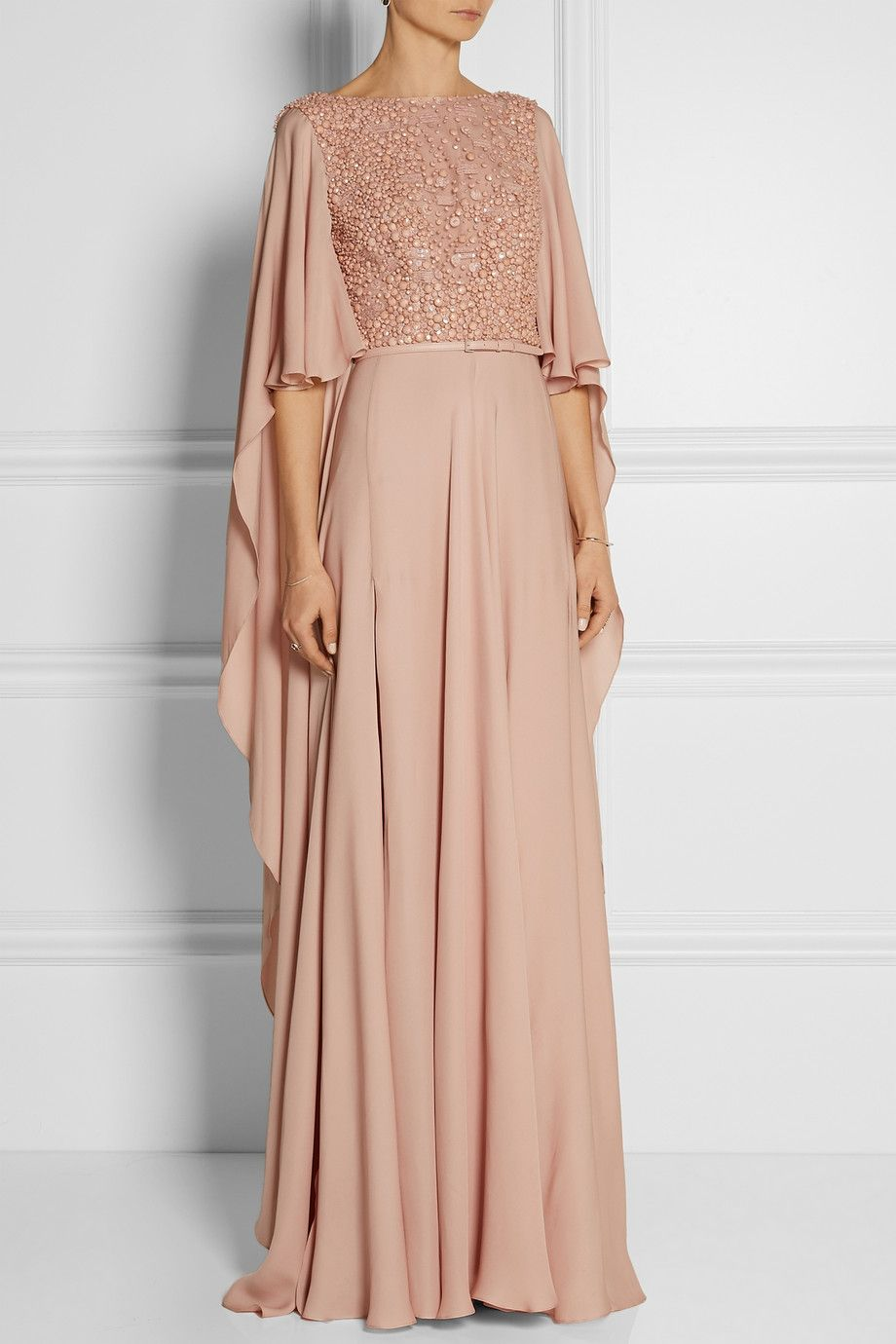 Elie Saab   Embellished belted silk gown   Cut from petal-soft blush silk, Elie Saab's Resort '15 gown looks even more exquisite when you move - it is finished with cape-style sleeves and a short train. The narrow leather belt flatters your waist and brings definition to the billowy fabric. Keep the focus on the heavily embellished bodice by styling this piece with delicate jewelry. #gorgeous #divine #gowns #feminine #elegant #classy #style #fashion #blush
