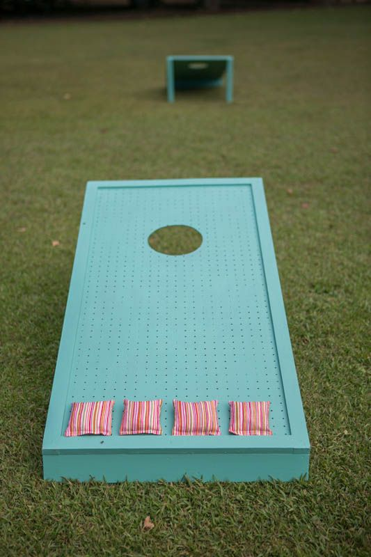 Easy DIY, who doesn't have cornhole at their backyard party?? #designsponge #dssummerparty