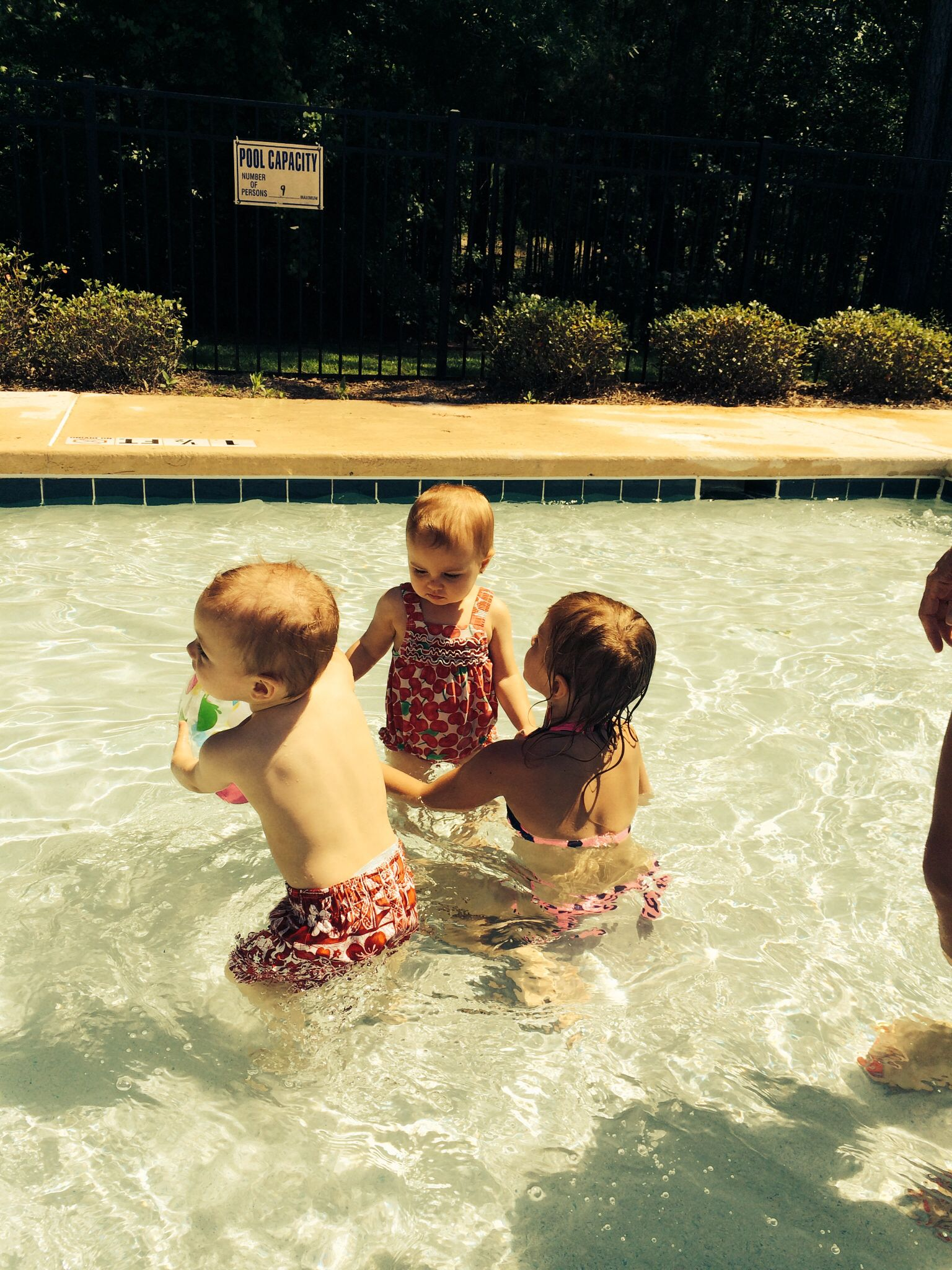 Mia and the twins first time swimming this year.