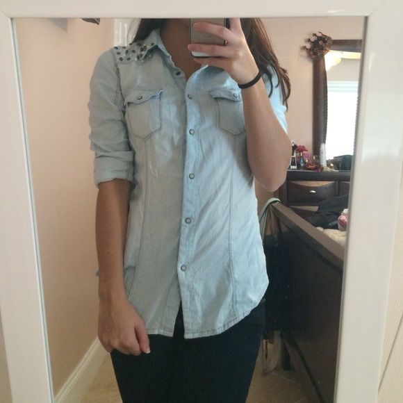 Long sleeve button up Light blue jean button up. Sleeves can be rolled up or left long with buttons for a better fit. Has fake pearls and well as dark silver beads sewed onto both shoulders. Fitted. Forever 21 Tops Button Down Shirts