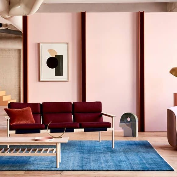 Millenial pink wall, blue rug and burgundy couch. | Home is Where ...