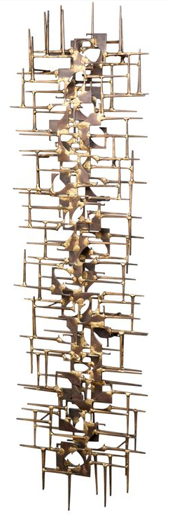 This type of art piece would be interesting on your dining room wall. It would be nice to find a complementary piece to balance the 2 areas on either side of the windows. Brutalist art wall sculpture