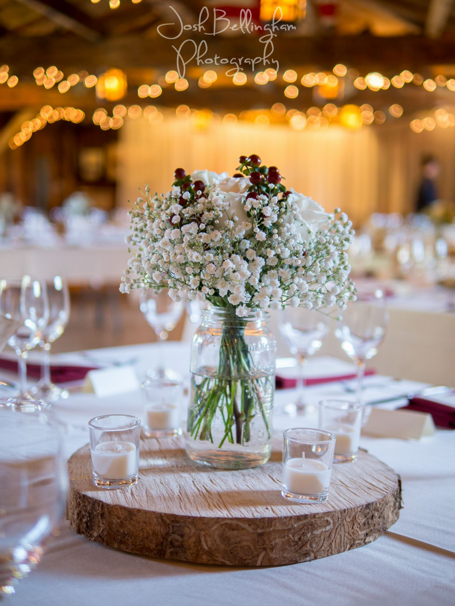 Gorgeous Babys Breath on Wooden Wedding Centerpieces I love the sparkling lights in the