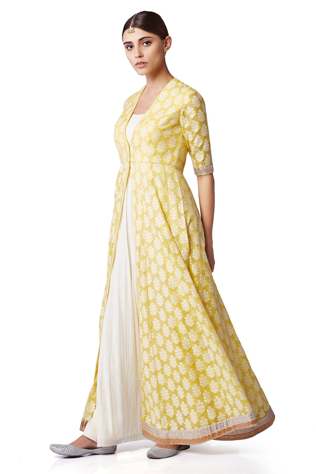 An elegant tunic in gentle hues of yellow with an intricate