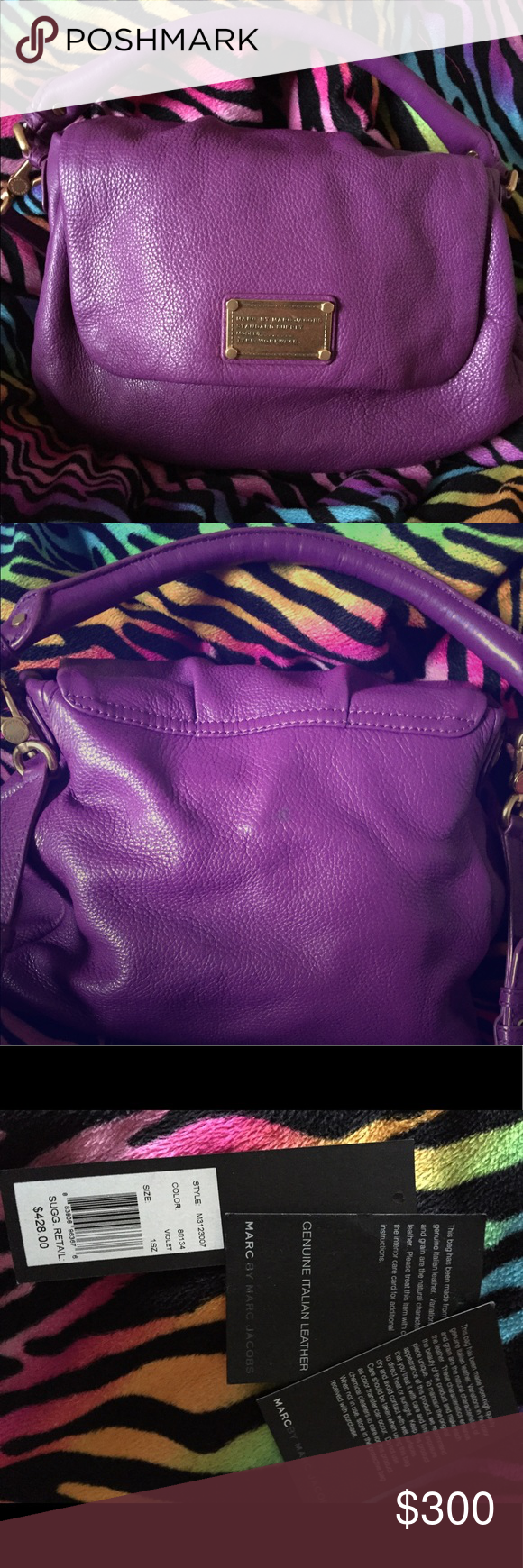 Marc By Marc Jacobs Classic Q This bag is a pretty purple (violet) color. It has a lot of room and I only used it about 4 times. It has no stains or damage. This bag is in very good condition. Marc by Marc Jacobs Bags Shoulder Bags