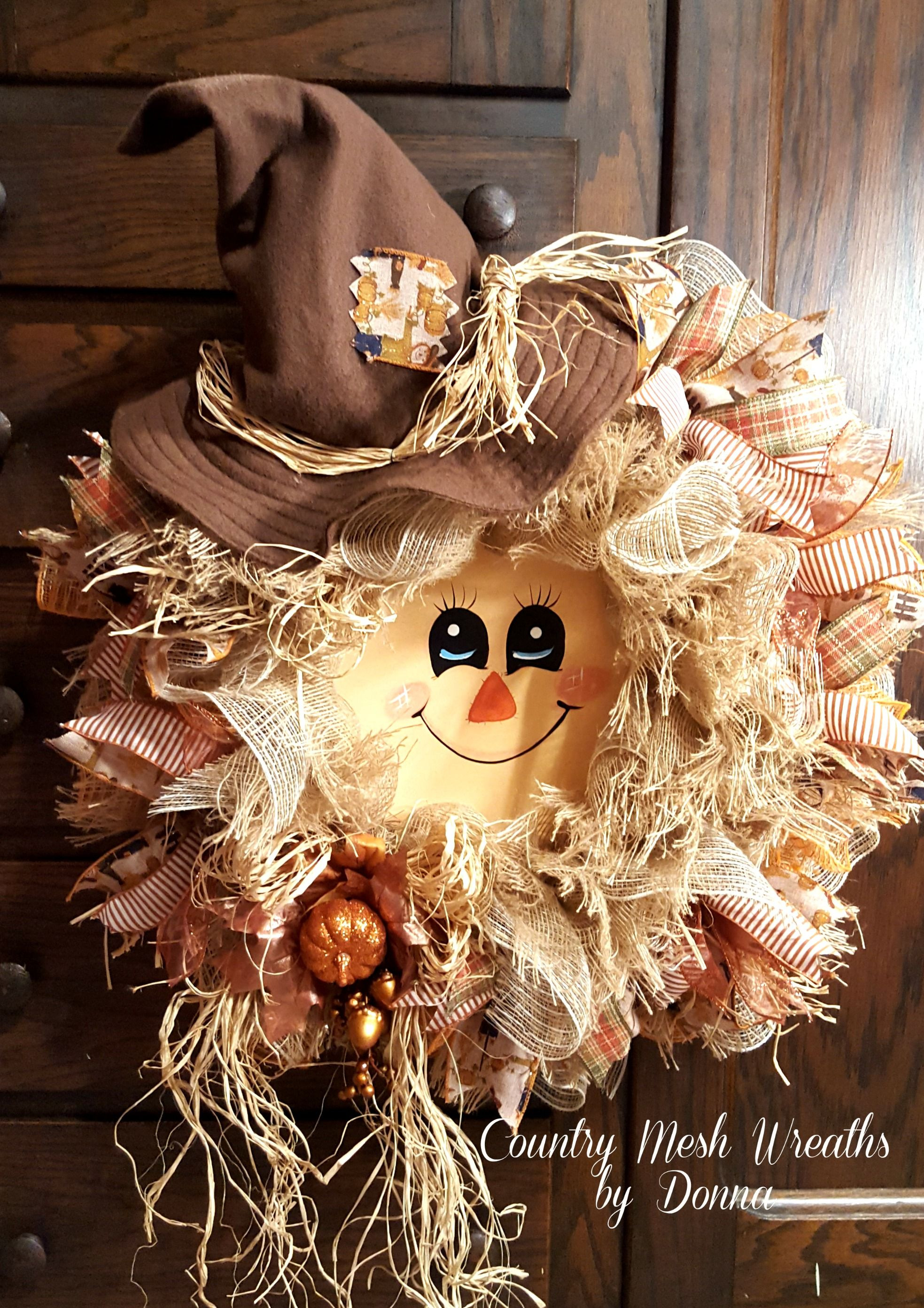 scarecrow wreath for fall hand painted face and handmade hat frayed burlap mesh and ivory burlap mesh oodles of ribbon