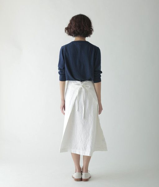 Cut from Fog's thicker linen, the Cindy is a faux wrap skirt. You'll step into the skirt and wrap ... two wings in the front or the back
