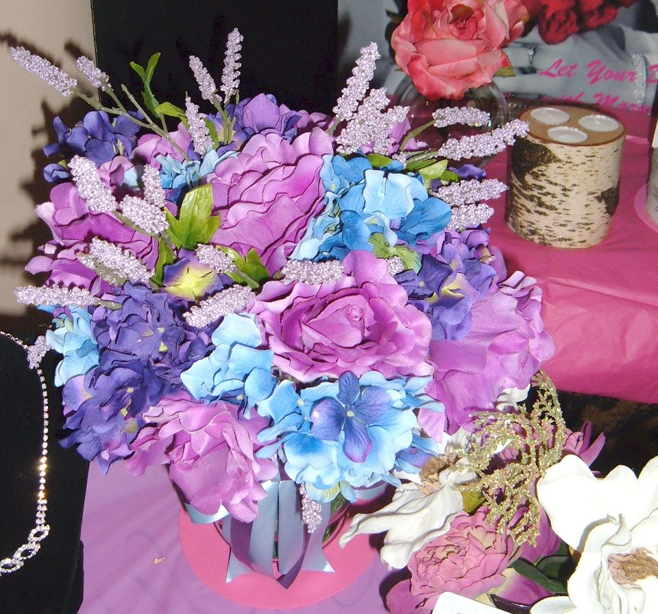 Silk arrangement in blue and lavender roses with lavender