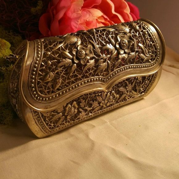 Gorgeous, Vintage Metal Clutch. Amazing vintage clutch. Carefully detailed filigree with birds and flowers all over carved into silver tone metal body. Metal has not been tested but appears to be silver plate. Has two small hooks where a chain or cord could be attached to carry as a small shoulder bag. This bag is truly gorgeous, a real show stopper. Bags Clutches & Wristlets