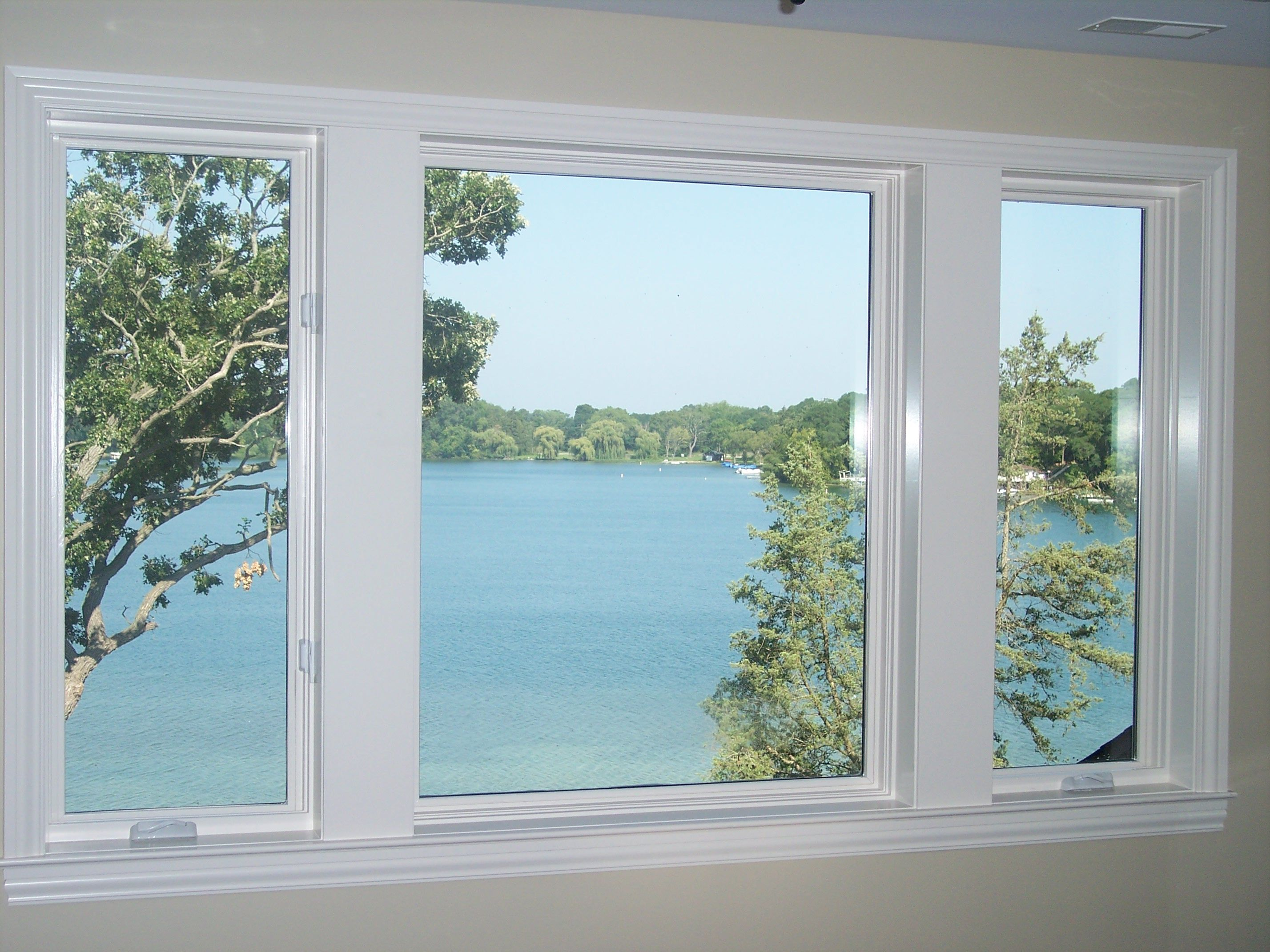 Upstairs lake views through picture window encased by two Lake house windows