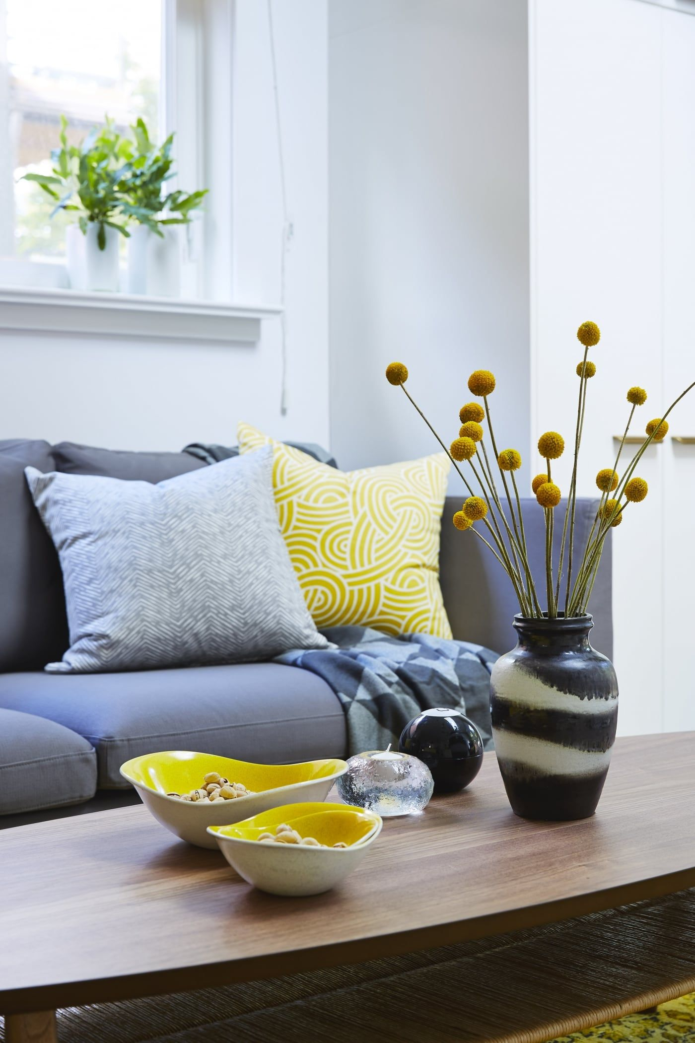 Sunny Side Up Living Room Detail Grey Sofa With Lighter Grey Pillows And Floral Arrangement Living Room Decor Room Decor Grey Pillows
