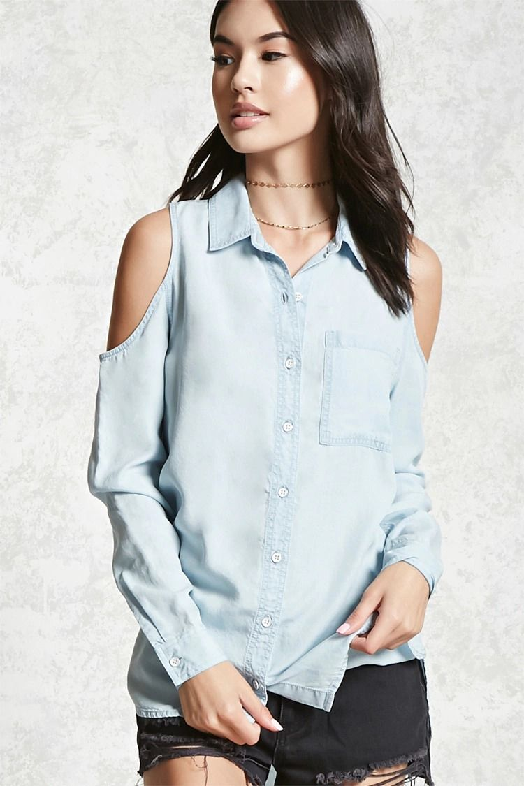 5358a195f7a215 A chambray shirt featuring open shoulders