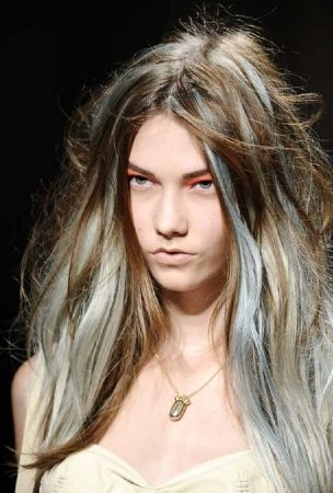 Not this expression on the face, but i do love the hair.  long wavy brown middle parted hair with pastel blue and grey highlights