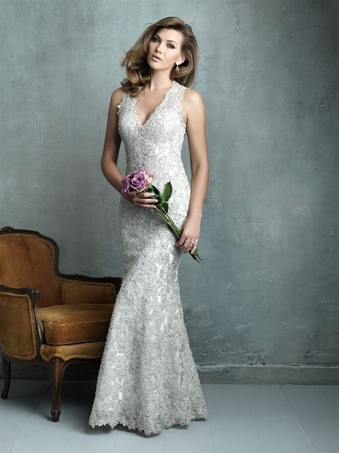 This dress by Allure Bridals is stunning. Every inch of this slim-fitting sheath is covered in lace applique and shimmering beadwork.