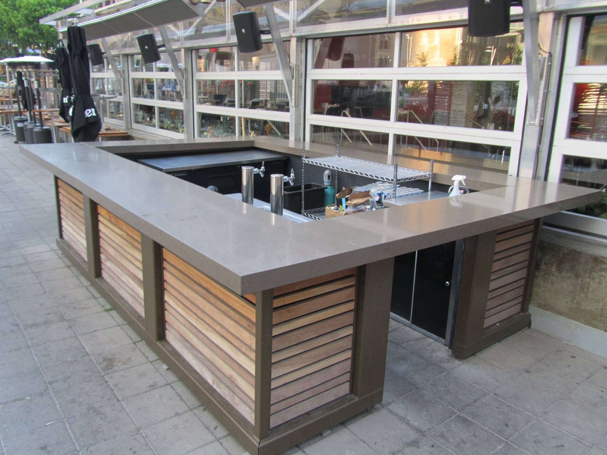 Caesar Stone patio bar with powder coated steel base and cedar