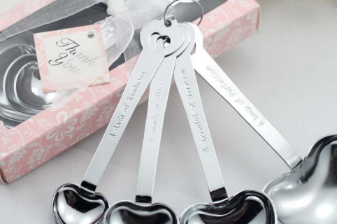 "Romantic Chrome Measuring Spoon Four Piece Gift Set with the following engraved in each: ""A PINCH OF JOY"" on the 1/4 teaspoon, ""A DASH OF TENDERNESS"" on the 1/2 teaspoon, ""A SPOONFUL OF AFFECTION"" on the 1 teaspoon and ""A HEAP OF LOVE"" on the 1 tablespoon. Tablespoon measures 5"" long with rest being shorter. Comes in plastic Gift Pack with White Bow and card attached that reads ""LOVE BEYOND MEASURE"".Note: The boxes comes in pink & light blue. The order will be shipped in random mix of these…"