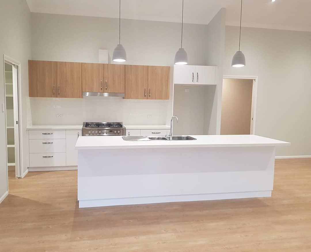 Loving The Constrast Of White And Woodgrain In This Kitchen Set Off By Some Beautiful Pen Hand Blown Glass Chandelier Glass Chandelier Blown Glass Chandelier