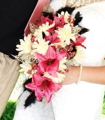 Wedding Flowers I made from dollar tree flowers and some feathers from hobby lobby, and glitter leaves from kirklands