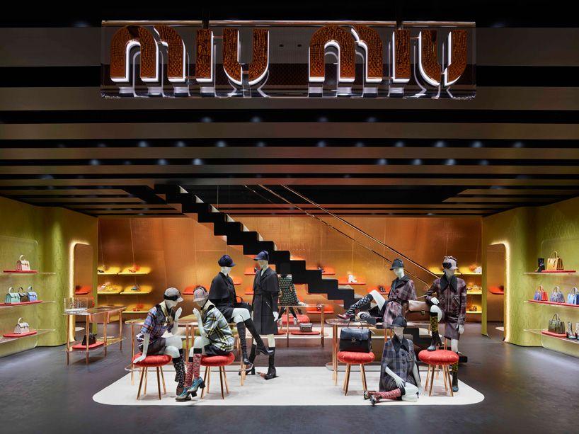 09878024a38c3 herzog   de meuron clads miu miu store with angled canopy