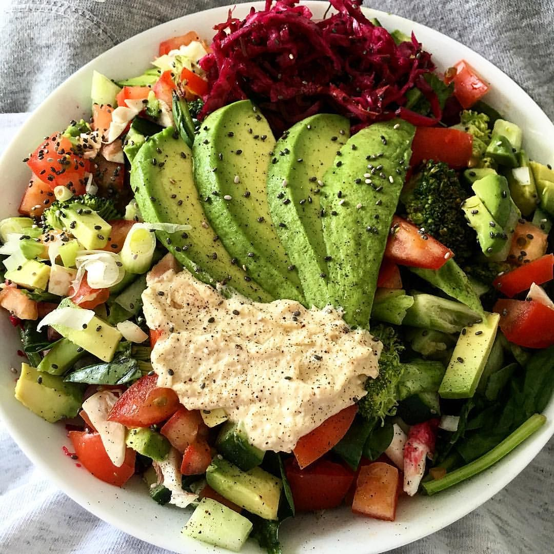 Avocado, Spring onion, Tomato, Cucumber, Broccoli, Spinach leaves, Hummus, Sauerkraut, beetroot and chia seeds.. Even added mushrooms and couldn't even tell they were in there (thankgod lol)  (via shana-makins)