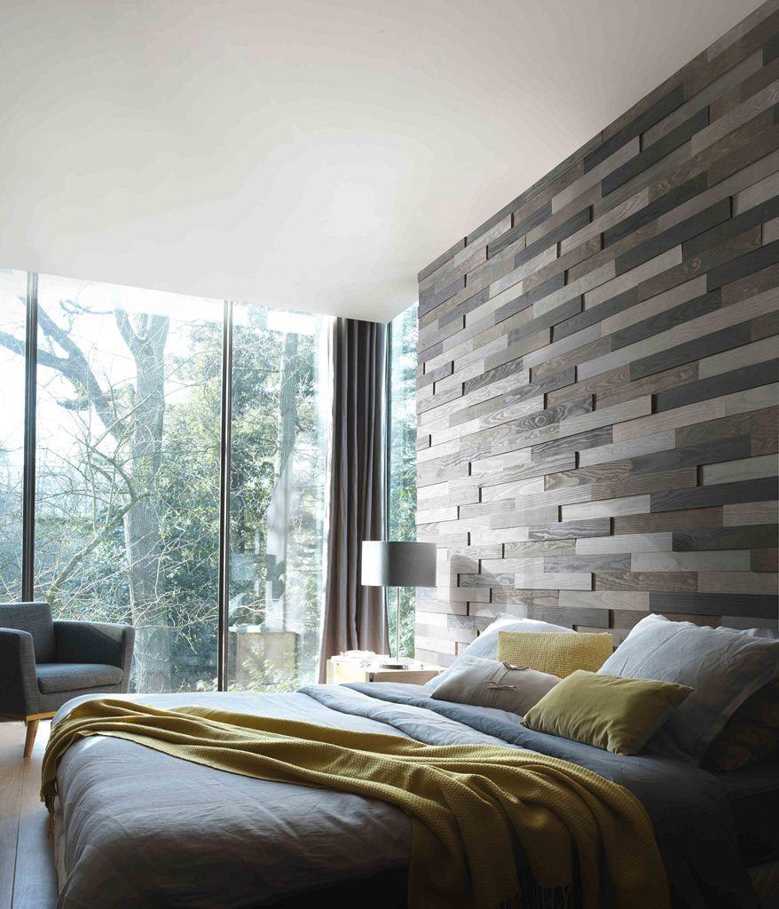 une t te de lit sur toute la hauteur du mur en relief et en bois nuanc de gris avec le moma de. Black Bedroom Furniture Sets. Home Design Ideas