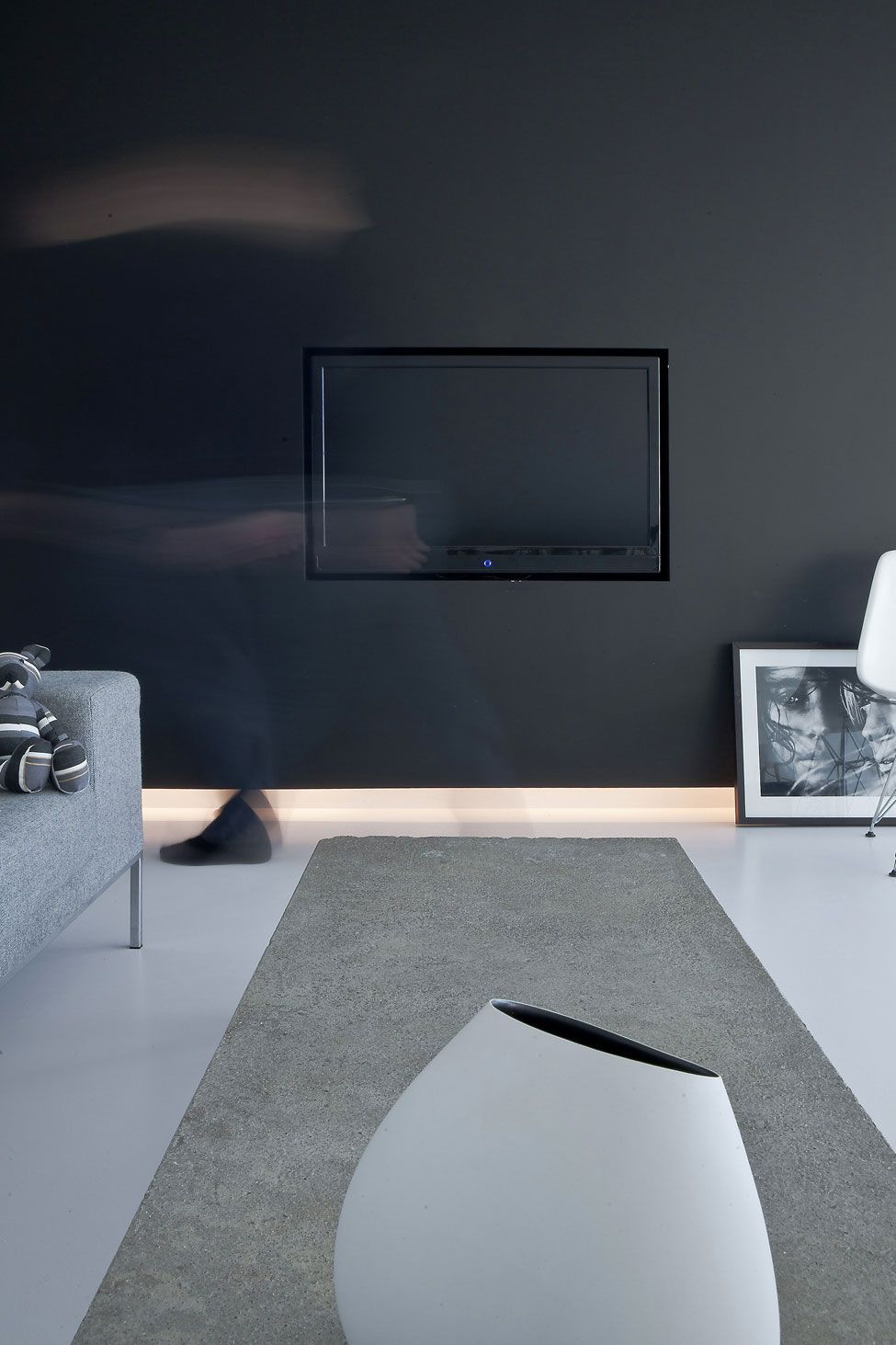 I detest having a television visible inside the living room because somehow it always becomes a focus of the entire room. If it really needs to be done and can't be hidden this is the way to do it. Penthouse II in Copenhagen by Norm Architects.