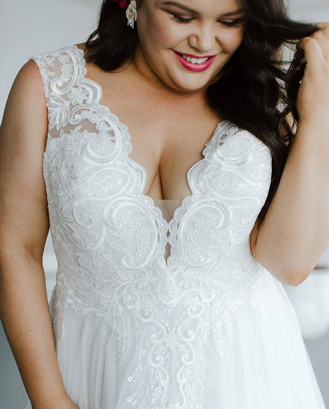 Plus size bride smiling and wearing beautiful flattering
