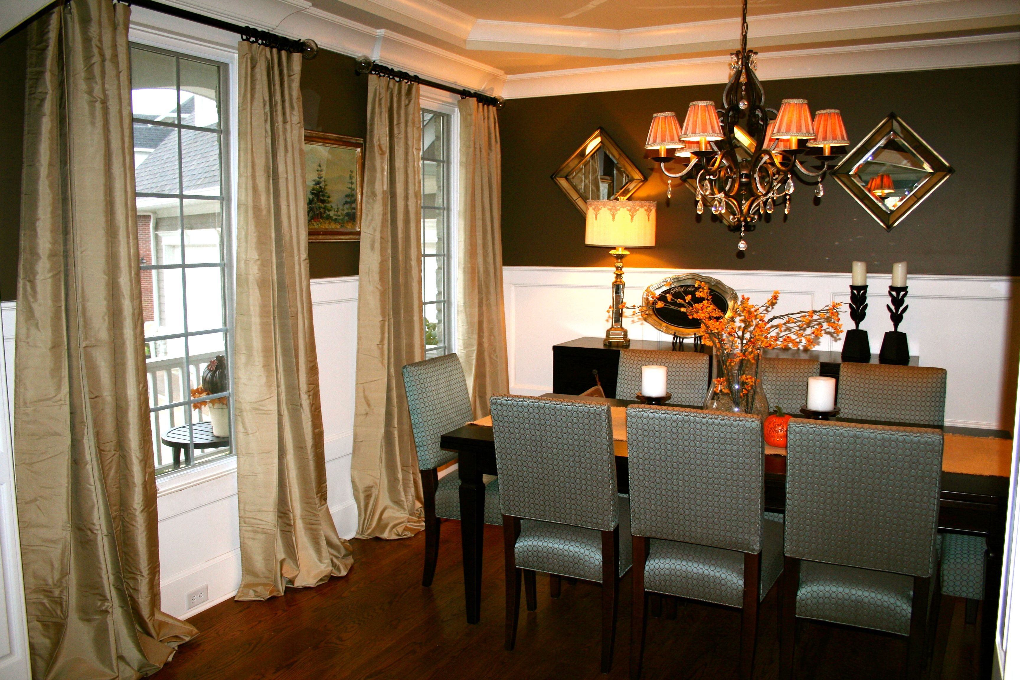 Silk Drapery Panels Puddle For A Formal Look In This Transitional Dining Room