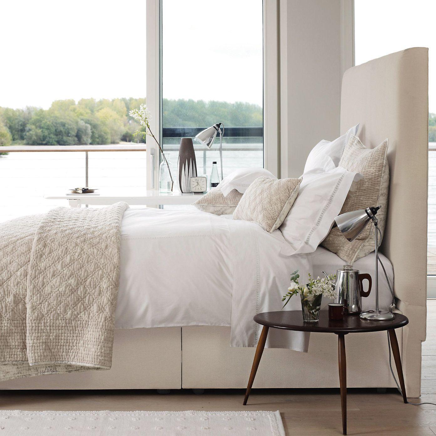 High fabric headboard cream neutral bedroom