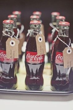 attach escort cards to mini coca-cola bottles