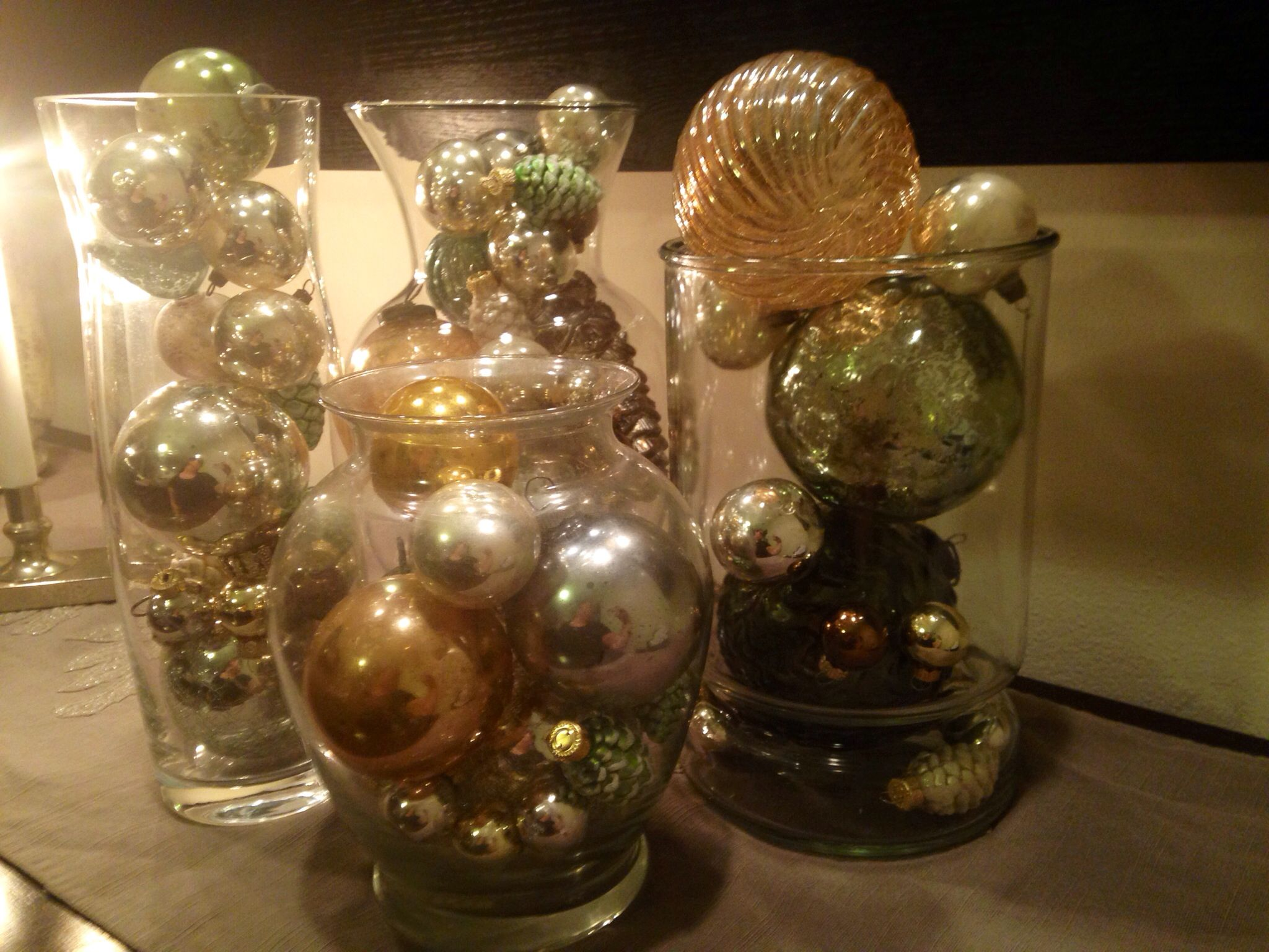Fill glass vases with antique and new Christmas ornaments!