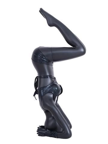 egghead female mannequin in yoga headstand pose