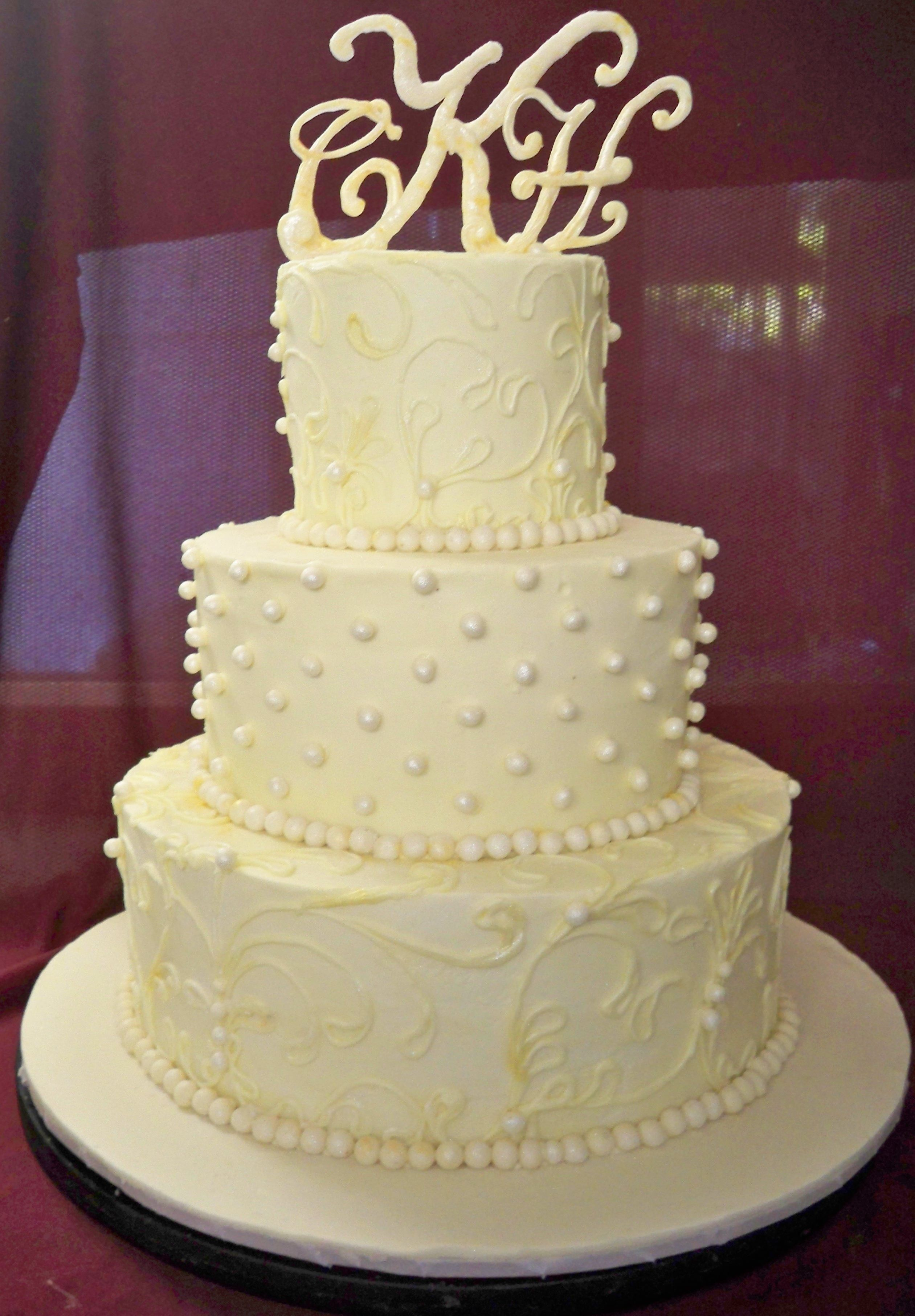 white butterceam wedding cake with lace and shimmer decoration http ...
