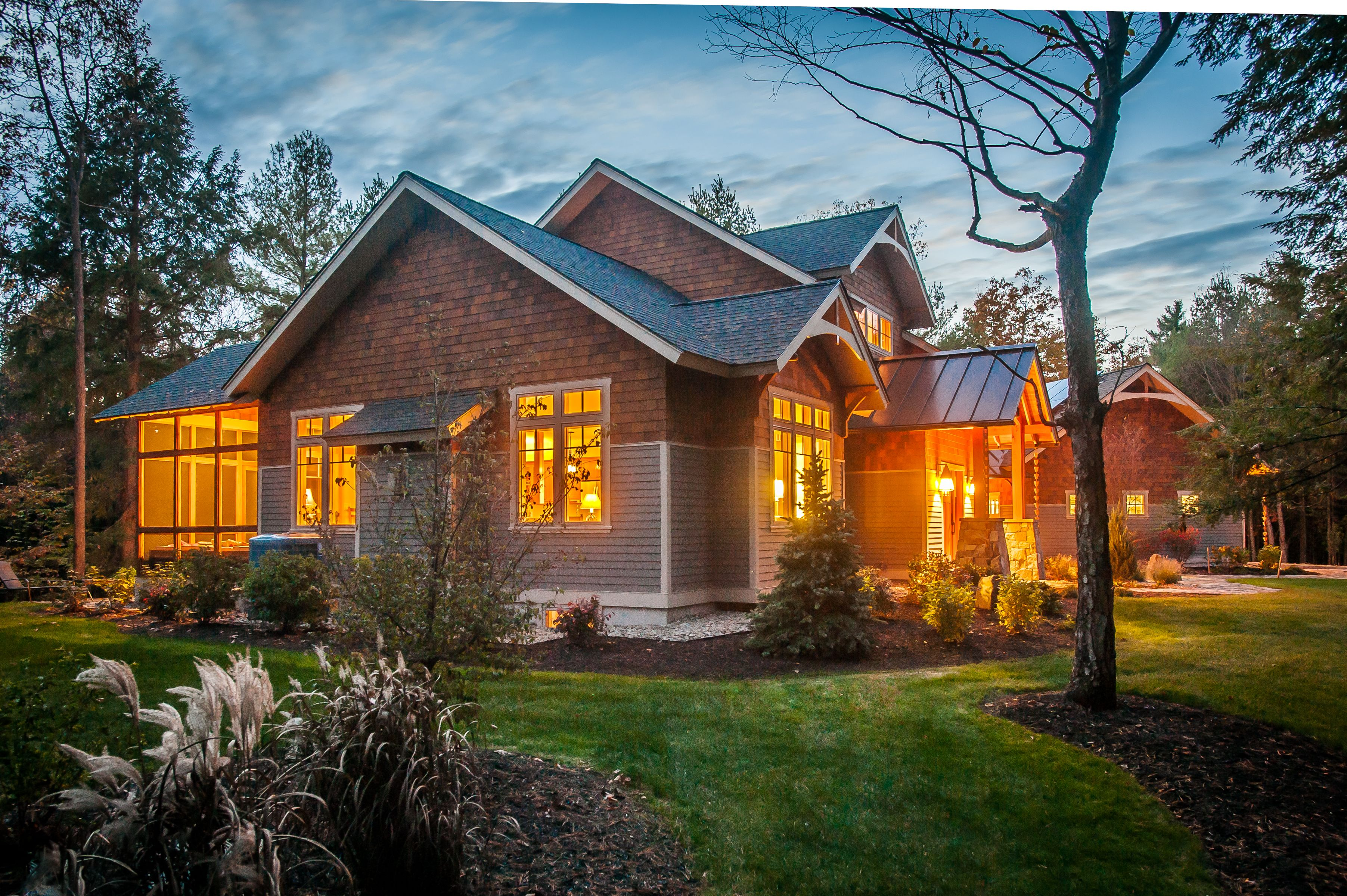 Side view, custom home exterior at dusk at Louden Ridge in Saratoga Springs, NY