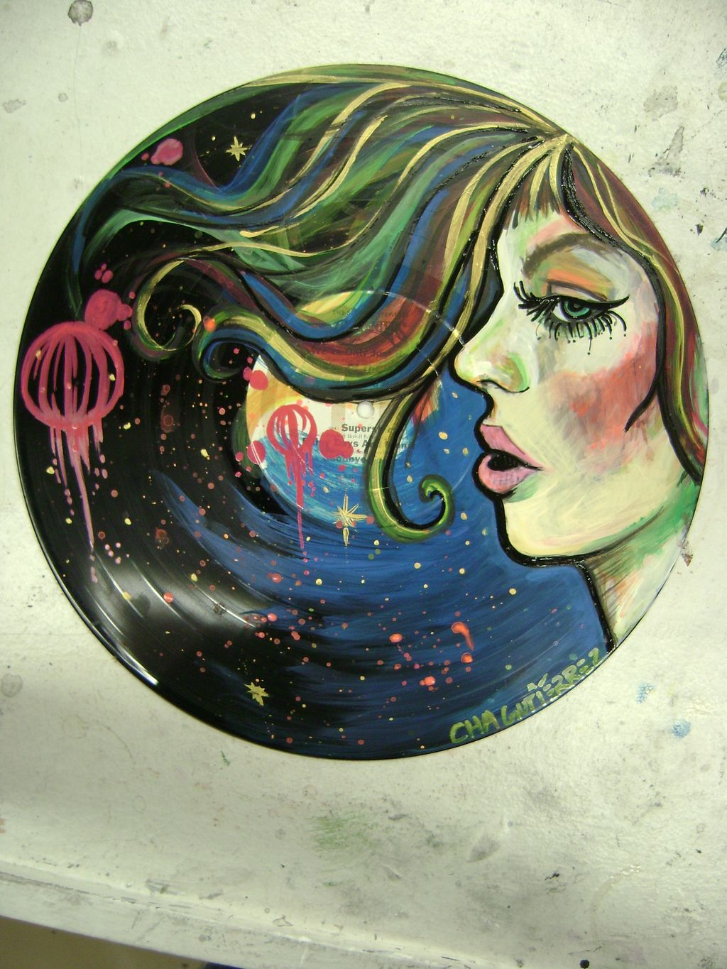 Painting on vinyl record by Charissa Guiterrez http ...