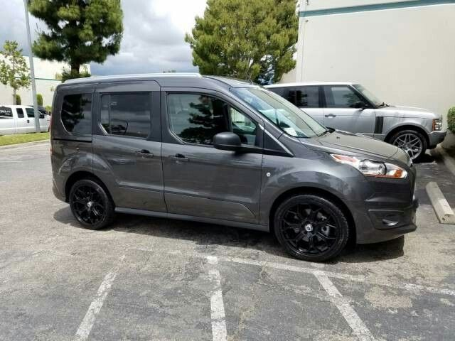 Ford Transit Connect Wagon Van On Black 19 Inch Wheels Ford Transit Bike Repair Cool Cars