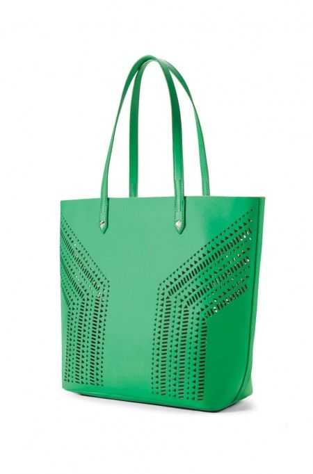 Tote around in style with this unique bag which includes a pouch