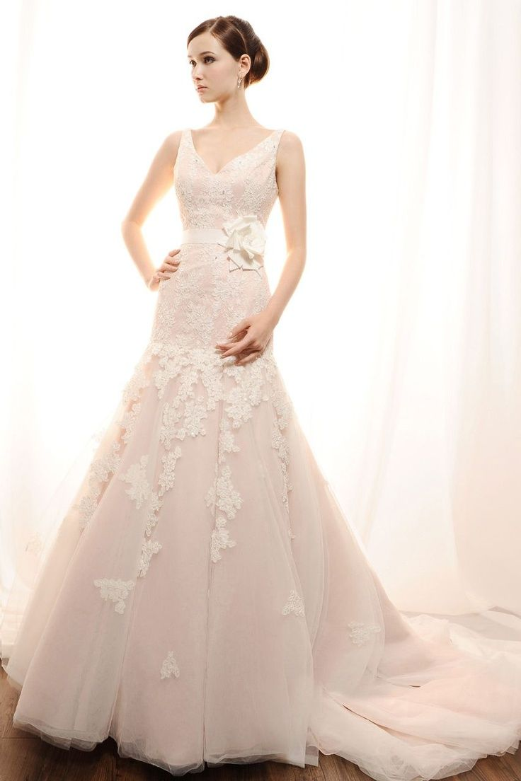I love the lace and slight vintage feel of this gown gorgeous and