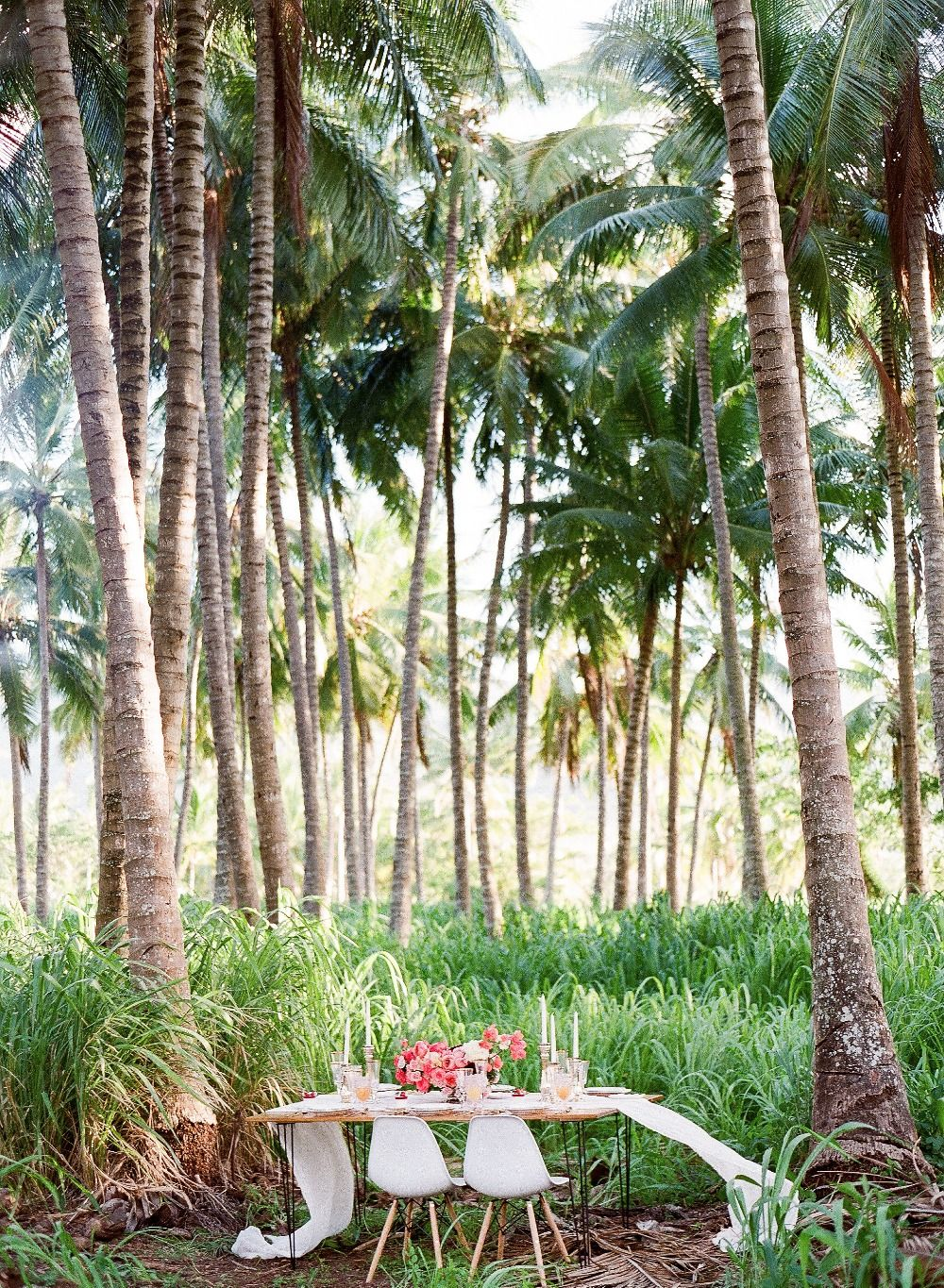 Tropical jungle wedding reception setting