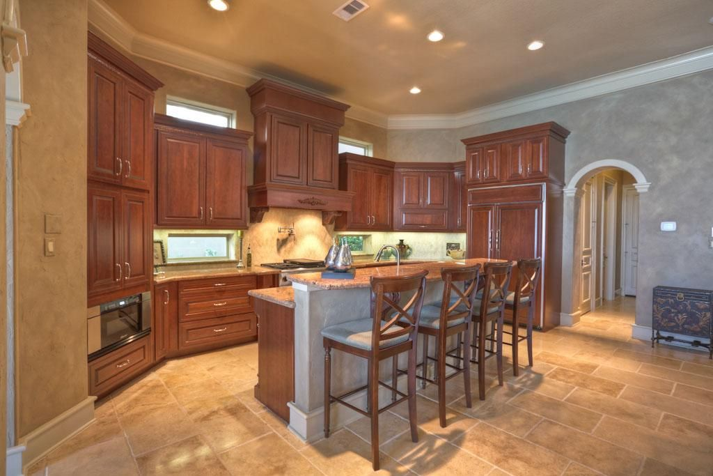 Kitchen 20x11 With Custom Kraftmaid Cabinetry Slab Granite Counters Center Island Stainless Steel Sink Counter And Breakfast