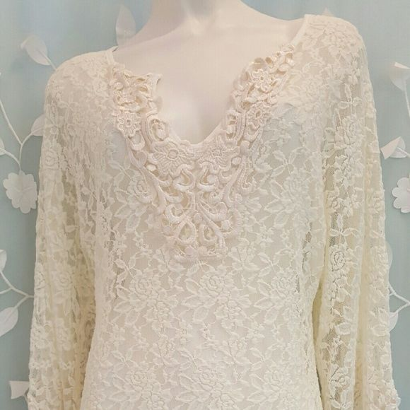 Women's Long Sleeve Lace Beach Cover Up Pre-washed never used, purchased it brand new with tags.  Very pretty lace beach cover up. Demi Loon Swim Coverups