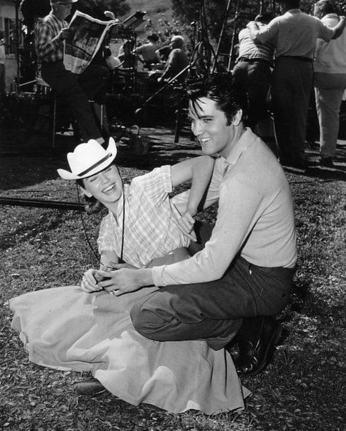 Elvis and Dolores Hart, horsing around while filming LOVING YOU