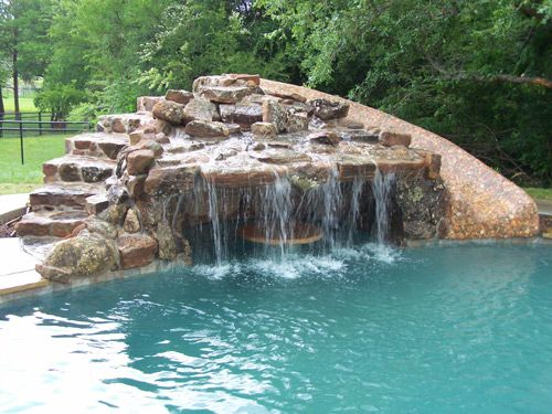 pacific pool grotto slide with custom stone table - Swimming Pools With Grottos
